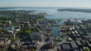 AX147_049 - 6k stock footage aerial video flying over coastal town along Salem Harbor, Salem, Massachusetts