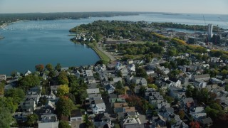 AX147_050 - 6k stock footage aerial video approaching an elementary school in a coastal town, Salem, Massachusetts