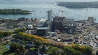 AX147_051 - 6k stock footage aerial video orbiting construction at a natural gas power plant, Salem, Massachusetts