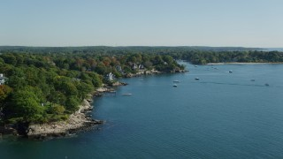 AX147_060 - 6k stock footage aerial video flying along oceanfront homes and fall leaves, autumn, Manchester-by-the-Sea, Massachusetts