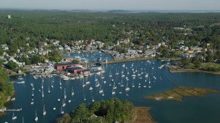 AX147_067 - 6k stock footage aerial video flying over harbor with boats in autumn, Manchester-by-the-Sea, Massachusetts