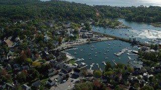 AX147_070 - 6k stock footage aerial video orbiting a coastal community and harbor, Manchester-by-the-Sea, Massachusetts