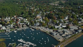 AX147_072 - 6k stock footage aerial video flying by harbor, coastal community, autumn, Manchester-by-the-Sea, Massachusetts
