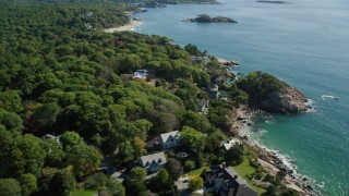 AX147_074 - 6k stock footage aerial video flying by oceanfront homes to Graves Island, Manchester-by-the-Sea, Massachusetts