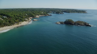 AX147_075 - 6k stock footage aerial video flying by Graves Island, oceanfront homes, Manchester-by-the-Sea, Massachusetts