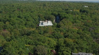 AX147_078 - 6k stock footage aerial video flying by mansion, dense trees, autumn, Manchester-by-the-Sea, Massachusetts