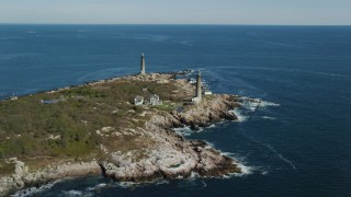 AX147_110 - 6k stock footage aerial video approaching two lighthouses on an island, Thatcher Island, Massachusetts