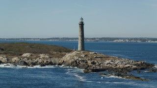 AX147_112 - 6k stock footage aerial video orbiting a lighthouse on Thatcher Island, Massachusetts