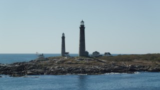 AX147_113 - 6k stock footage aerial video orbiting two light houses on Thatcher Island, Massachusetts