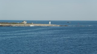 AX147_115 - 6k stock footage aerial video approaching a lighthouse, Straitsmouth Island, Rockport, Massachusetts