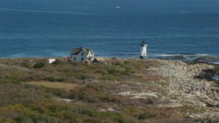 AX147_116 - 6k stock footage aerial video orbiting a lighthouse, Straitsmouth Island, Rockport, Massachusetts