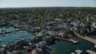 AX147_120 - 6k stock footage aerial video flying by harbor and small coastal town, Rockport, Massachusetts