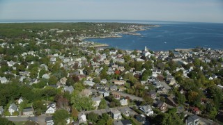 AX147_124 - 6k stock footage aerial video orbiting a small coastal town, Rockport, Massachusetts