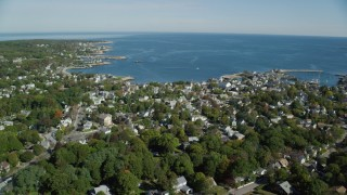 AX147_125 - 6k stock footage aerial video of a small coastal town with views of the water, Rockport, Massachusetts
