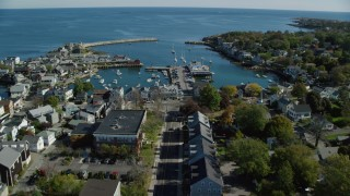 AX147_128 - 6k stock footage aerial video flying over coastal town and Broadway toward harbor, Rockport, Massachusetts