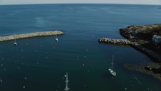 AX147_129 - 6k stock footage aerial video flying over harbor toward the ocean, Rockport, Massachusetts