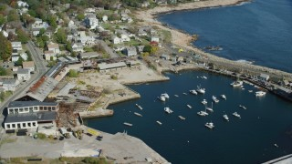 AX147_130 - 6k stock footage aerial video of a small coastal town along a cove and the ocean, Rockport, Massachusetts