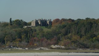 AX147_137 - 6k stock footage aerial video of The Great House, Crane Estate atop Castle Hill in autumn, Ipswich, Massachusetts