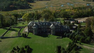 AX147_140 - 6k stock footage aerial video approaching and flying over The Great House at Crane Estate on Castle Hill, Autumn, Ipswich, Massachusetts