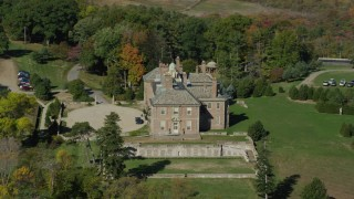AX147_142 - 6k stock footage aerial video orbiting The Great House at Crane Estate and Castle Hill in autumn, Ipswich, Massachusetts