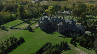 AX147_144 - 6k stock footage aerial video orbiting The Great House at Crane Estate on Castle Hill in autumn, Ipswich, Massachusetts
