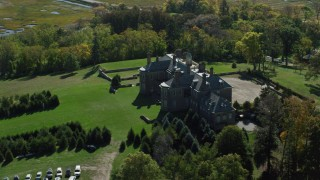 AX147_145 - 6k stock footage aerial video of a side view of The Great House at Crane Estate on Castle Hill in autumn, Ipswich, Massachusetts