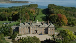 AX147_149 - 6k stock footage aerial video flying over The Great House at Crane Estate, Castle Hill, autumn, Ipswich, Massachusetts