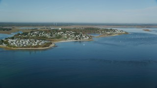 AX147_150 - 6k stock footage aerial video approaching a coastal town in autumn, Ipswich, Massachusetts