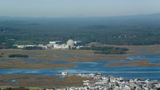 AX147_152 - 6k stock footage aerial video of a nuclear power plant along the water, autumn, Seabrook, New Hampshire