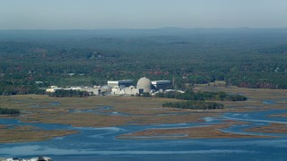AX147_153 - 6k stock footage aerial video passing a nuclear power station in autumn, Seabrook, New Hampshire