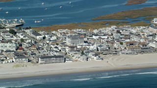 AX147_155 - 6k stock footage aerial video flying by a coastal town and beach, Hampton, New Hampshire