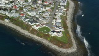 AX147_156 - 6k stock footage aerial video flying over a coastal neighborhood, Hampton, New Hampshire