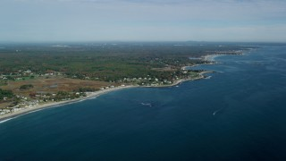 AX147_158 - 6k stock footage aerial video of autumn trees against a coastal community and coastline, Hampton, New Hampshire