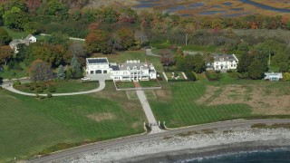 AX147_160 - 6k stock footage aerial video oceanfront mansion in autumn, North Hampton, New Hampshire