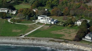 AX147_161 - 6k stock footage aerial video flying away from oceanfront mansions in autumn, North Hampton, New Hampshire