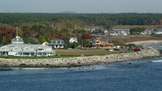 AX147_162 - 6k stock footage aerial video flying by oceanfront homes and new construction, autumn, Rye, New Hampshire