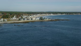 AX147_165 - 6k stock footage aerial video flying by ocean and beachfront homes in autumn, Rye, New Hampshire