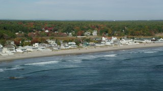AX147_166 - 6k stock footage aerial video flying by beachfront and oceanfront homes in autumn, Rye, New Hampshire