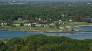 AX147_170 - 6k stock footage aerial video flying by waterfront mansions, autumn, Rye, New Hampshire