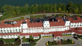 AX147_171 - 6k stock footage aerial video approaching Wentworth By The Sea hotel from the marina in autumn, New Castle, New Hampshire