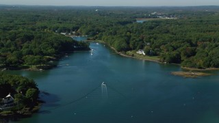 AX147_172 - 6k stock footage aerial video flying over a creek situated among trees, Rye, New Hampshire