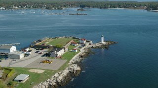 AX147_192 - 6k stock footage aerial video approaching lighthouses on New Castle Island in autumn, New Castle, New Hampshire