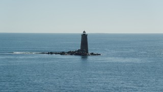 AX147_194 - 6k stock footage aerial video approaching a lighthouse in the middle of the water, Kittery, Maine