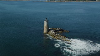AX147_196 - 6k stock footage aerial video flying away from lighthouse in the water, Kittery, Maine