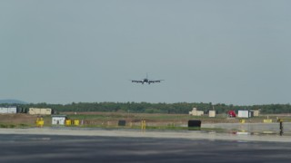 AX147_211 - 6k stock footage aerial video tracking military plane landing, Portsmouth International Airport, New Hampshire