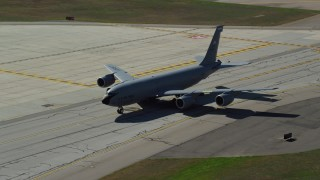 AX147_216 - 6k stock footage aerial video of a military plane taxiing, autumn, Portsmouth International Airport, New Hampshire