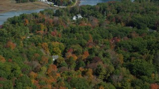 AX147_230 - 6k stock footage aerial video flying over colorful forest, rural homes, reveal York Harbor, Kittery and York, Maine