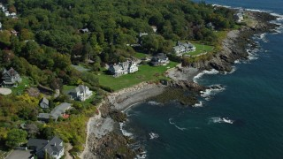 AX147_233 - 6k stock footage aerial video approaching upscale oceanfront homes, tilt down, autumn, York, Maine