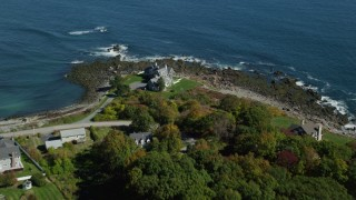 AX147_234 - 6k stock footage aerial video approaching upscale oceanfront homes, rocky shore, autumn, York, Maine