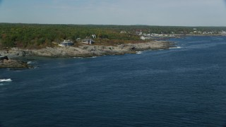 AX147_248 - 6k stock footage aerial video flying by oceanfront homes, colorful trees in autumn, Ogunquit, Maine
